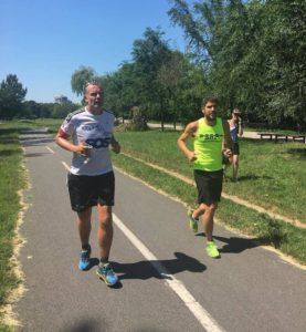 Mark left with Jeremy Lang from British Embassy in Serbia running through Belgrade